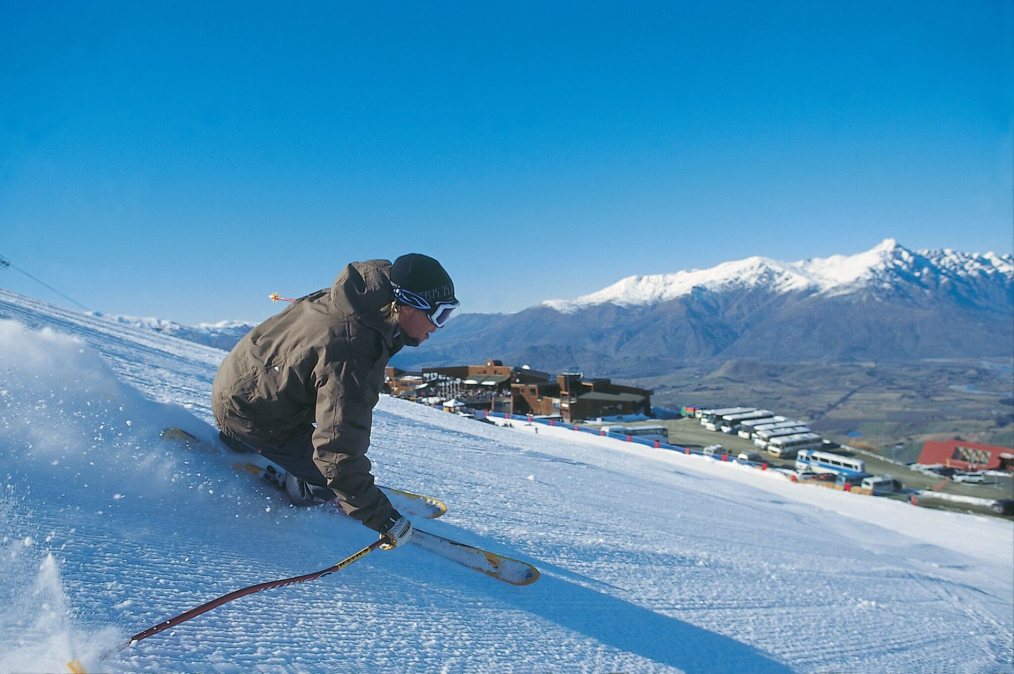 A man skiing at Coronet Peak ski field and resort - best place to visit in Queenstown in winter