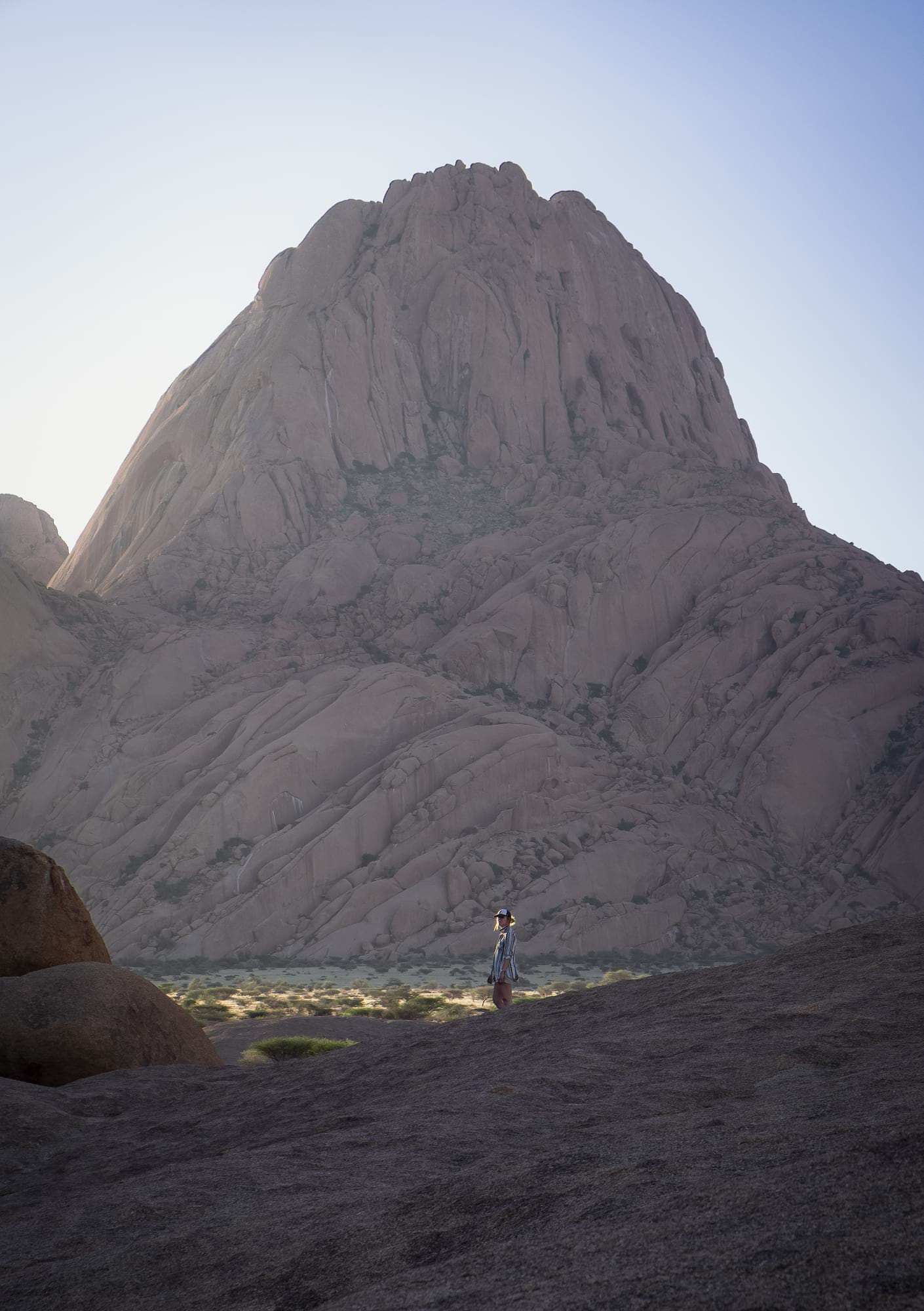 hiker at spitzkoppe namibia