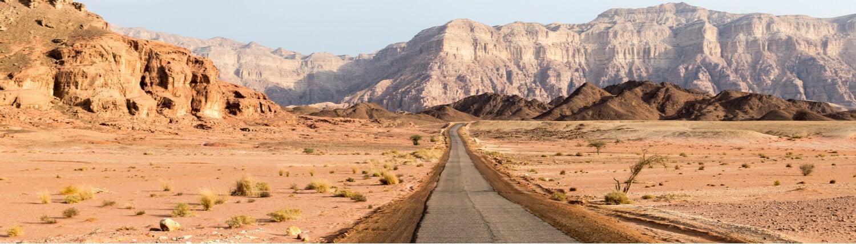 A long road running through the Negev Desert region of Israel