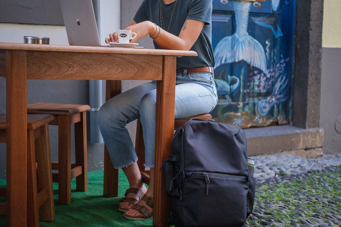black backpack at cafe
