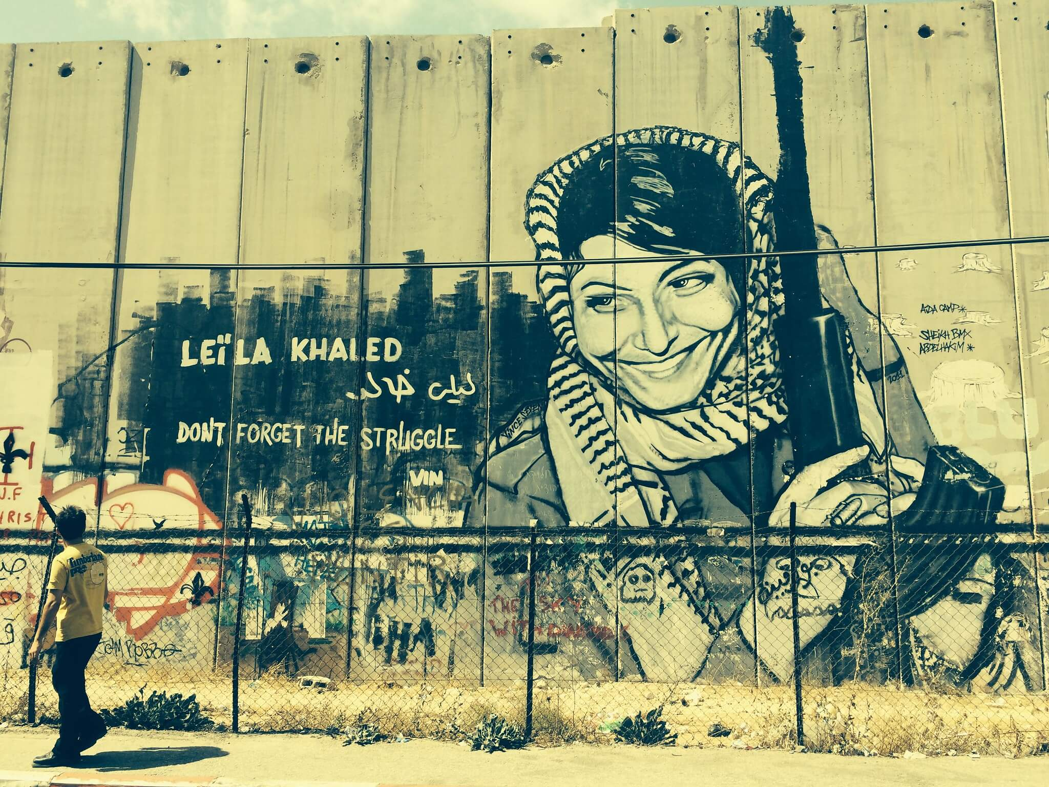 Street art mural of Leila Khaled on the Israeli West Bank barrier in Bethlehem
