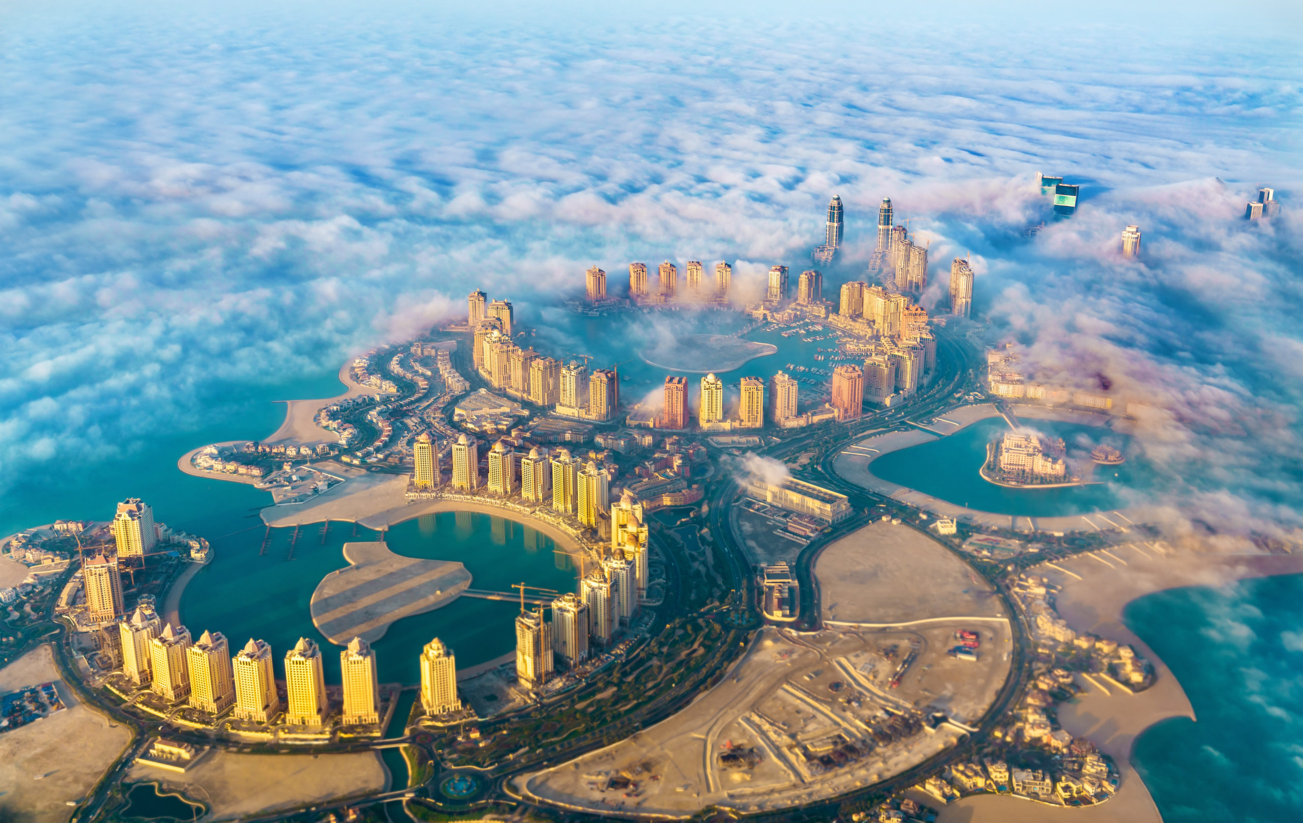 Aerial view of the Pearl-Qatar island in Doha through the morning fog. Qatar, the Persian Gulf. From Shutterstock - By Leonid Andronov