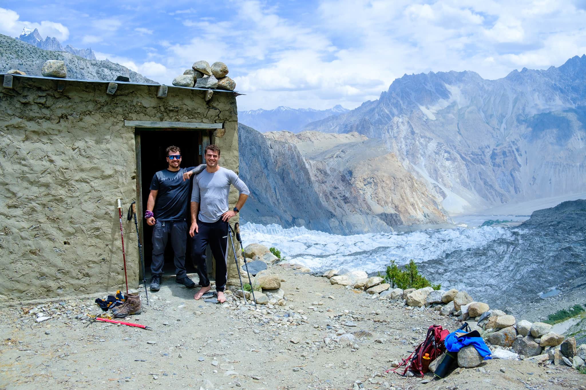 Will with a friend resting off their travel tiredness in a mountain hut