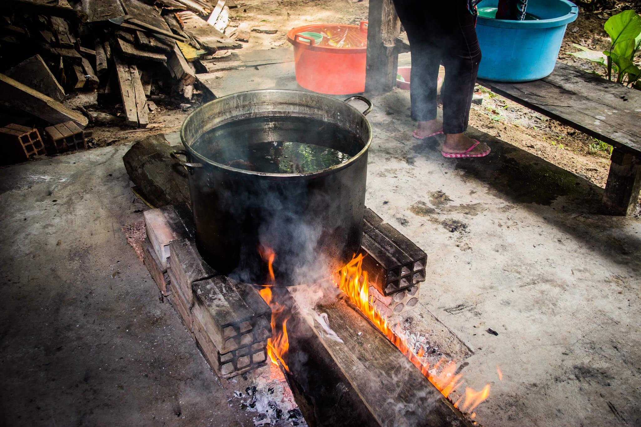 Drug Tourism in South America - Ayahuasca being brewed in a pot over a fire