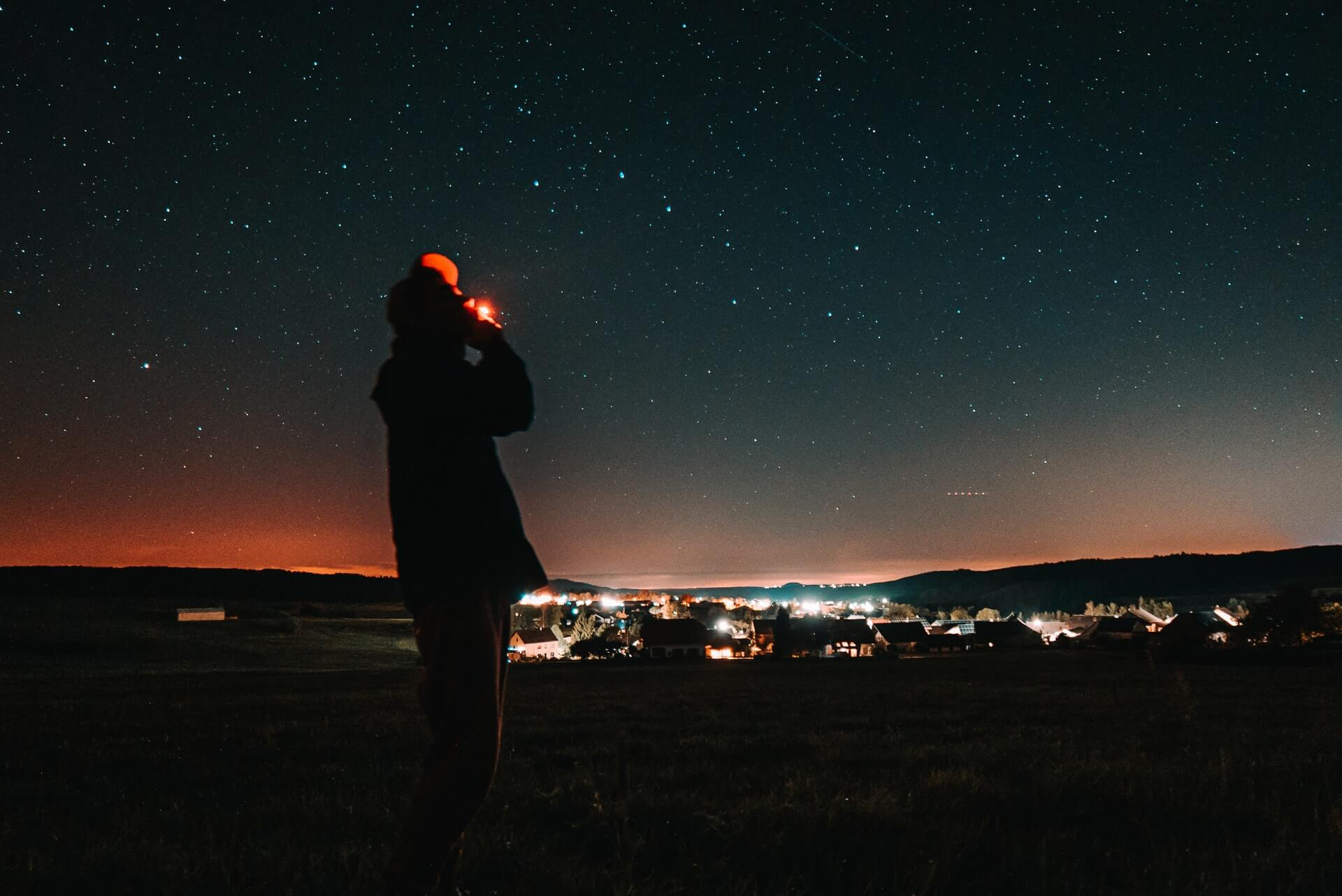 A man smoking a joint and taking drugs while travelling under the stars