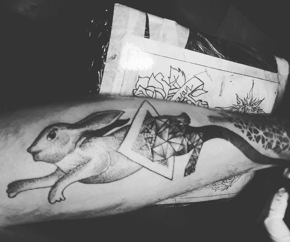 travel tattoo of a rabbit