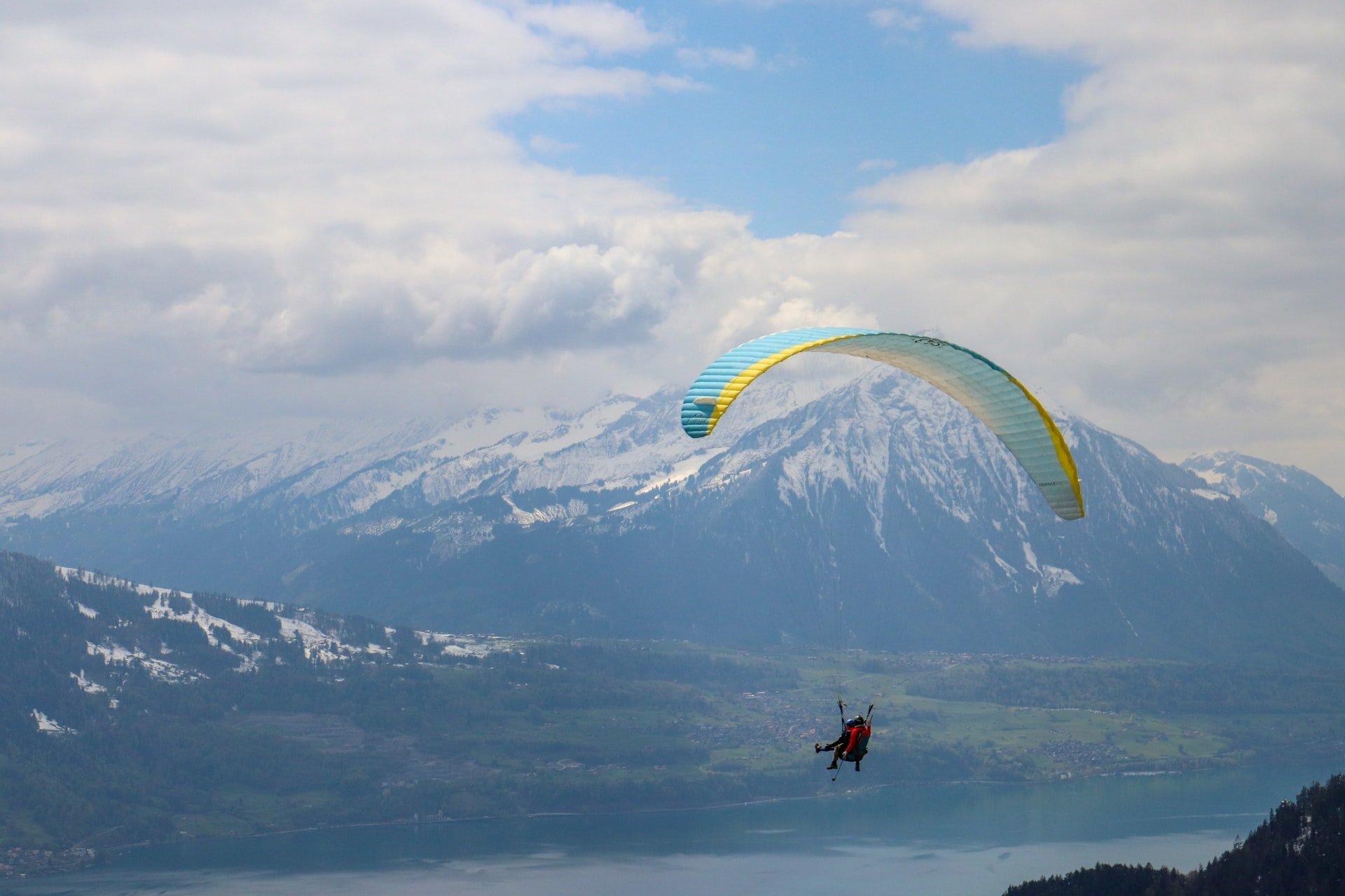 paragliding in mountains of interlaken switzerland