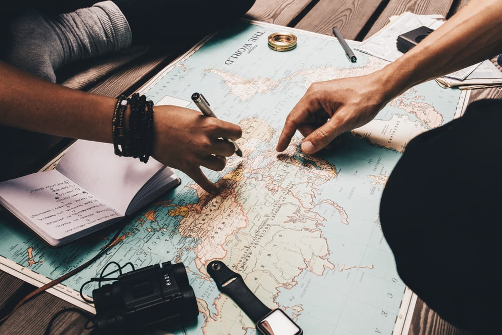 fingers pointing at a map planning a trip