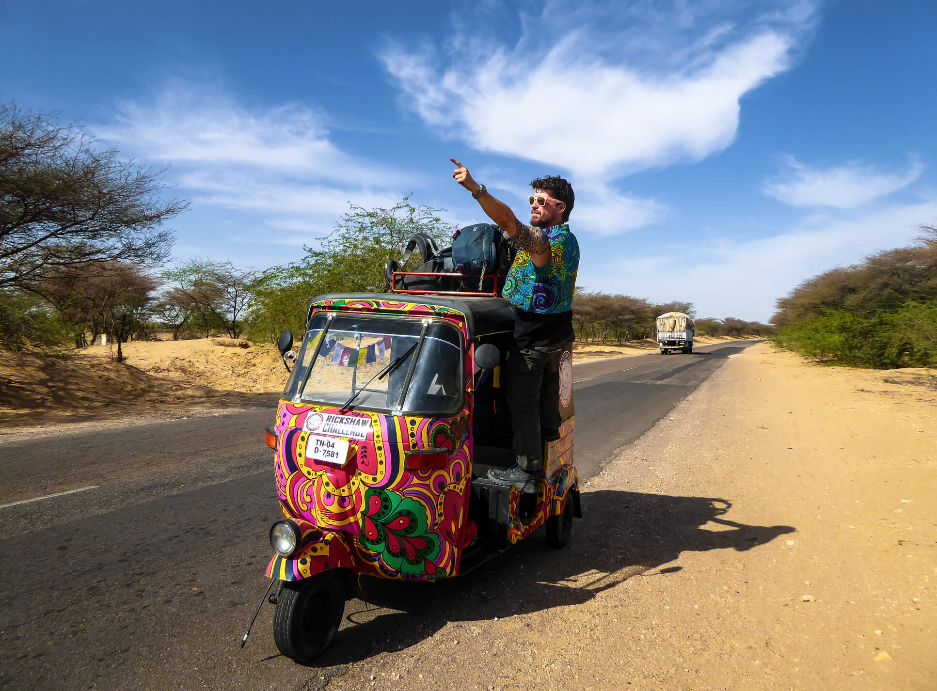 A backpacker achieving his ultimate bucket list experience of crossing India by tuk-tuk
