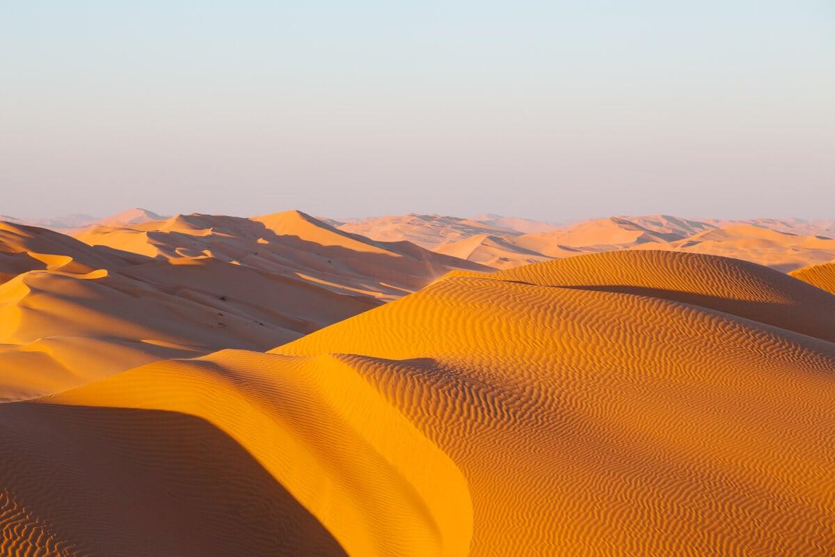 stunning orange-tan sand dunes in the empty quarter of oman