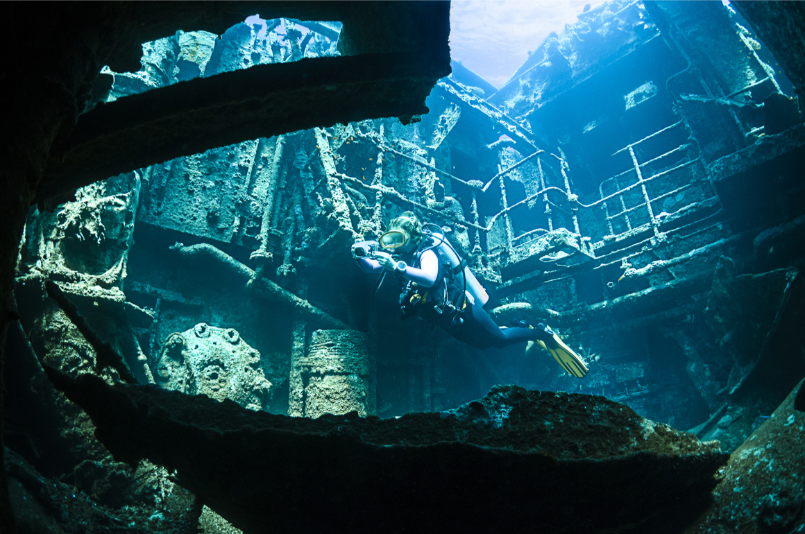 Scuba diver inside of a wreck in New Zealand.