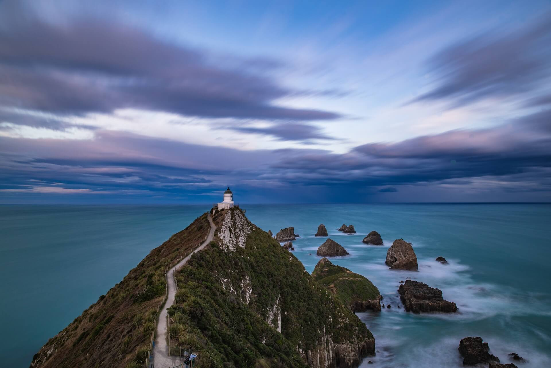 A moody sunrise on the Southern Scenic Route of New Zealand's South Island