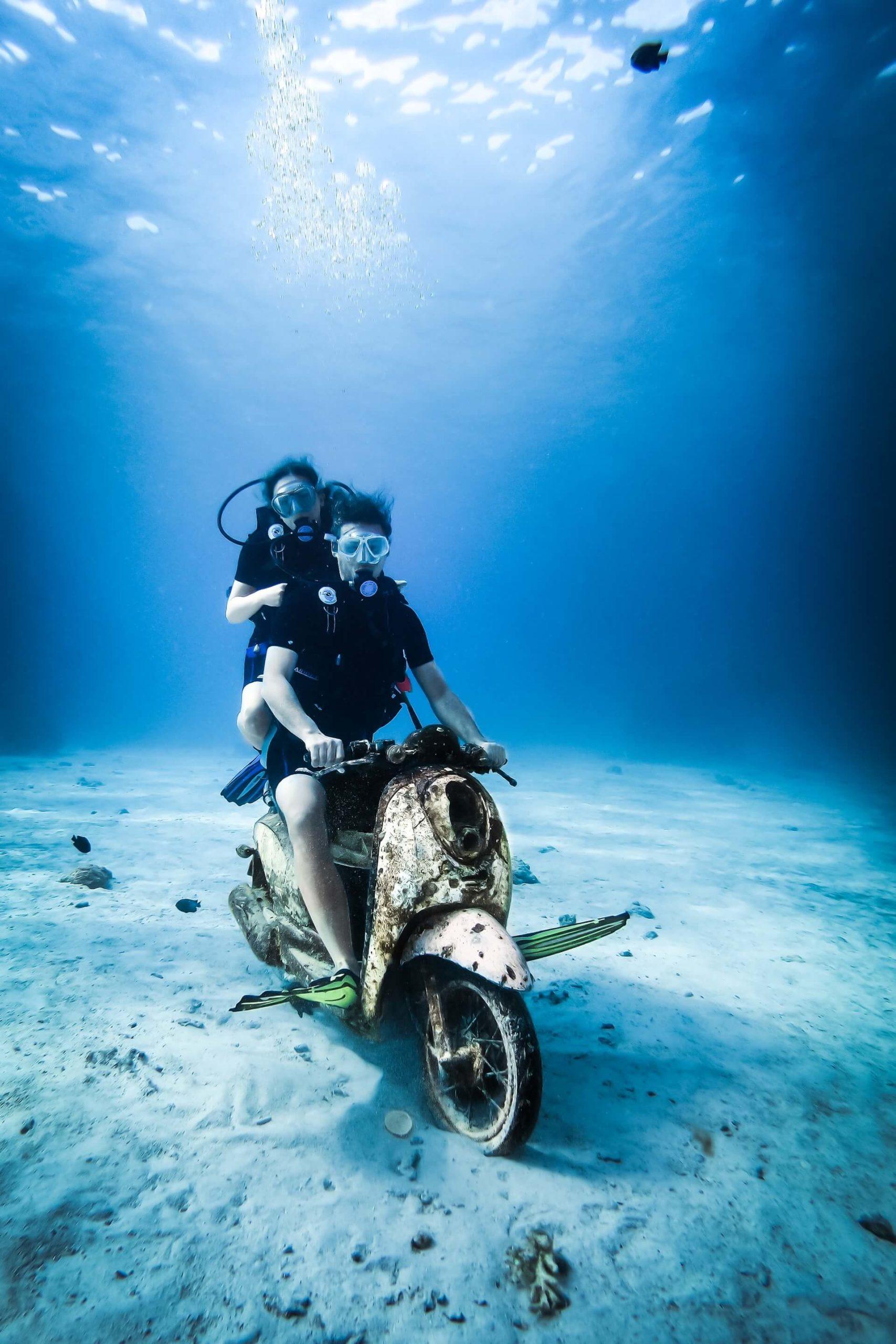 Two divers in New Zealand pulling some shenanigans on a submerged motorbike.