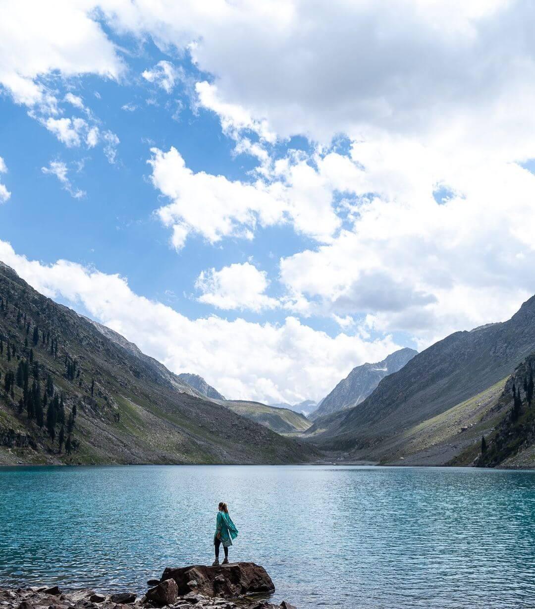 Samantha standing at a gorgeous laske in Pakistan