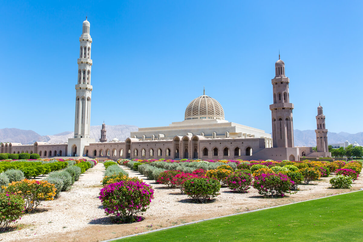 an outside view of the sultan qaboos mosque in muscat