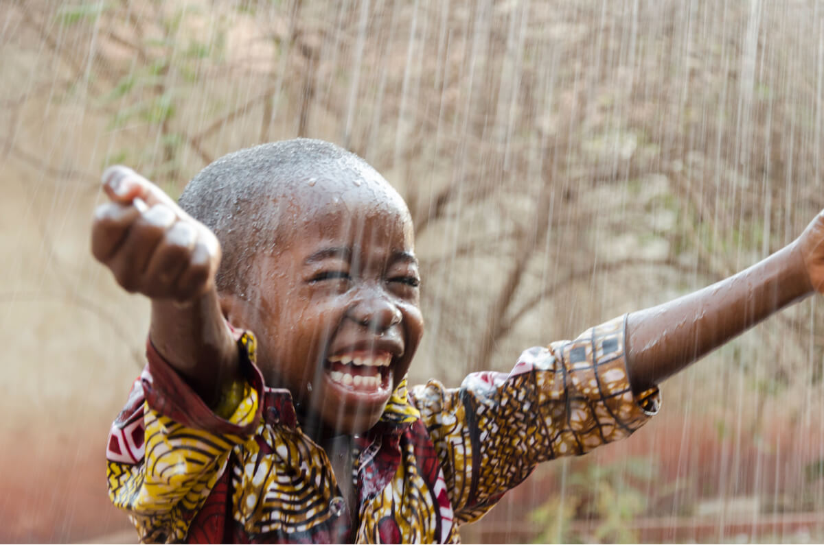 A very happy kid to receive the rains in Kenya