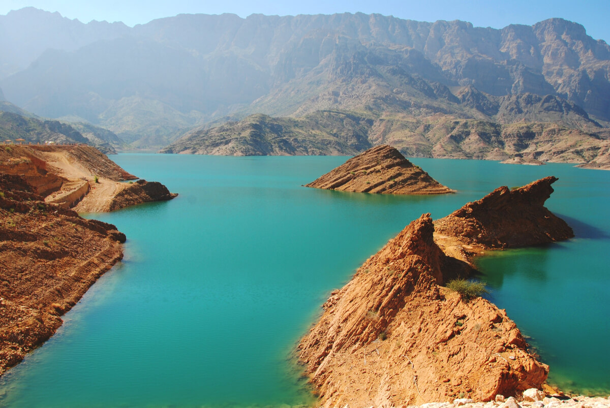 aerial shot of the turquoise waters and rock formations of wadi dayqah dam