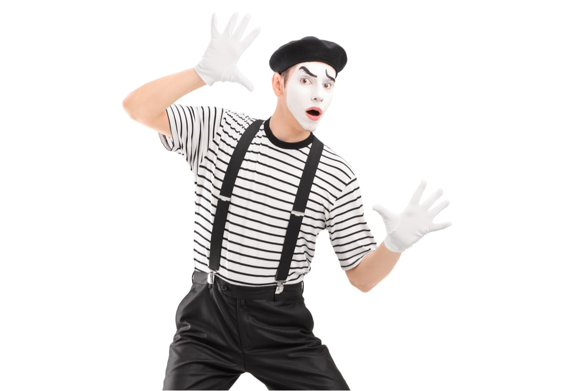 A mime presses against the screen.