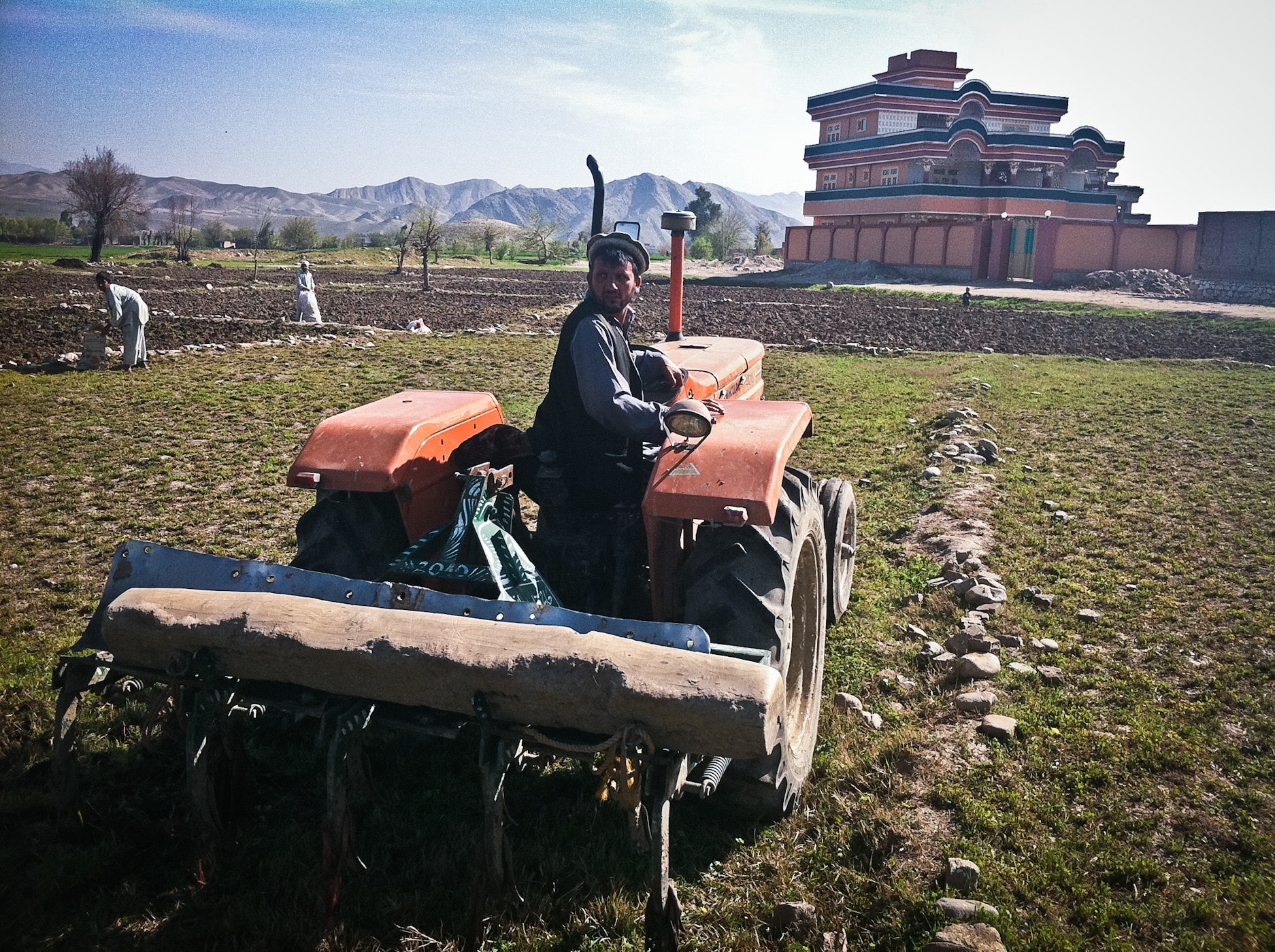 A man sits on his tractor in Afghanistan.