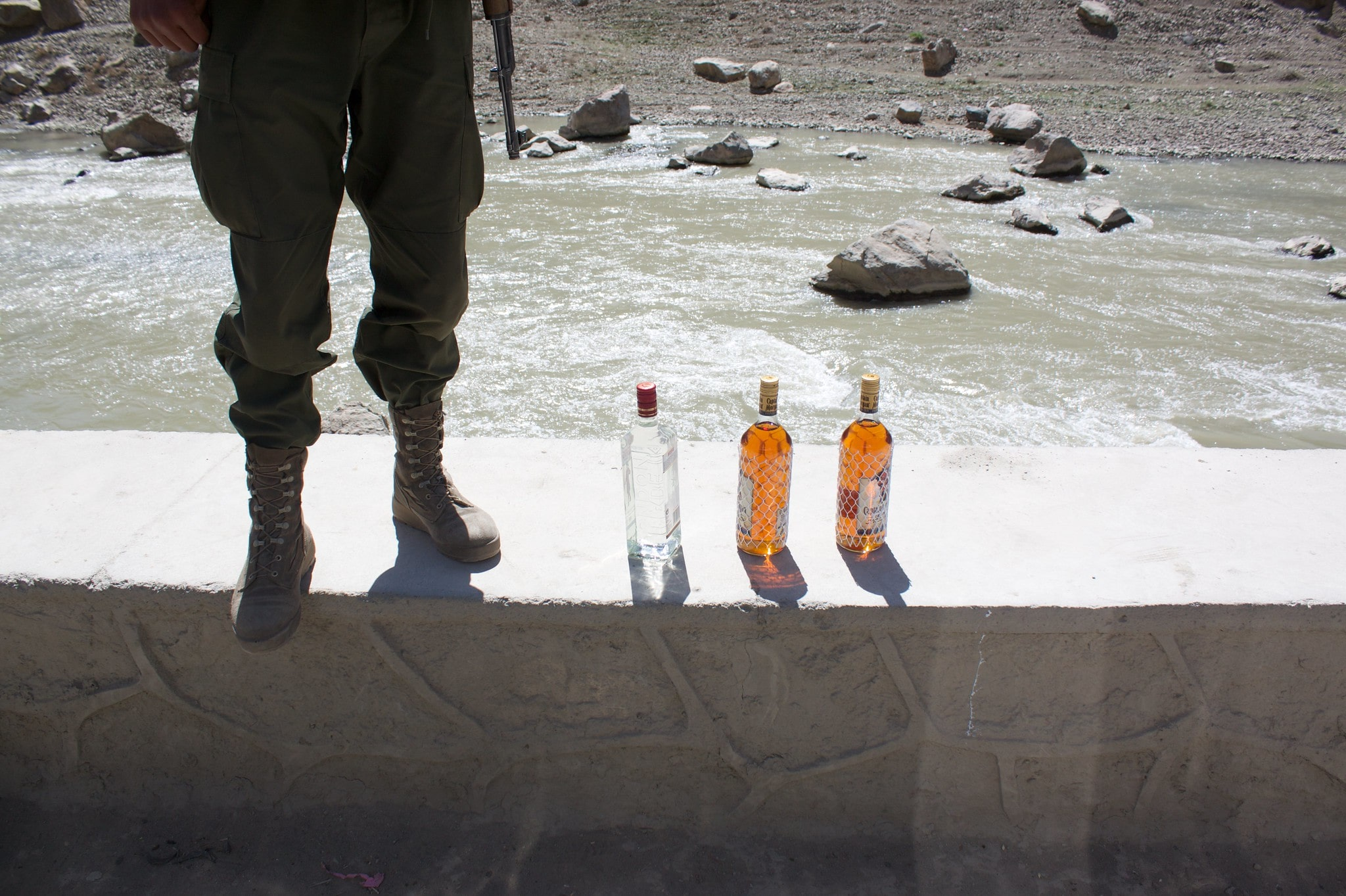Three bottles of alcohol and a soldier.