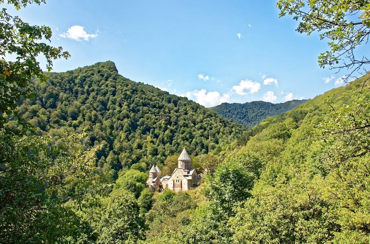 monastery from far away in the forest