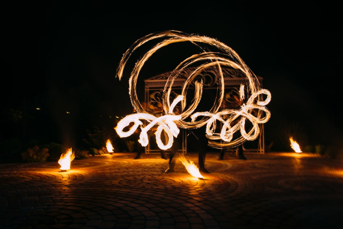 French Polynesian performers spin fire at night.