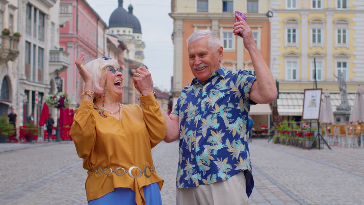 Two older couple laugh while trying to learn a new language travelling.