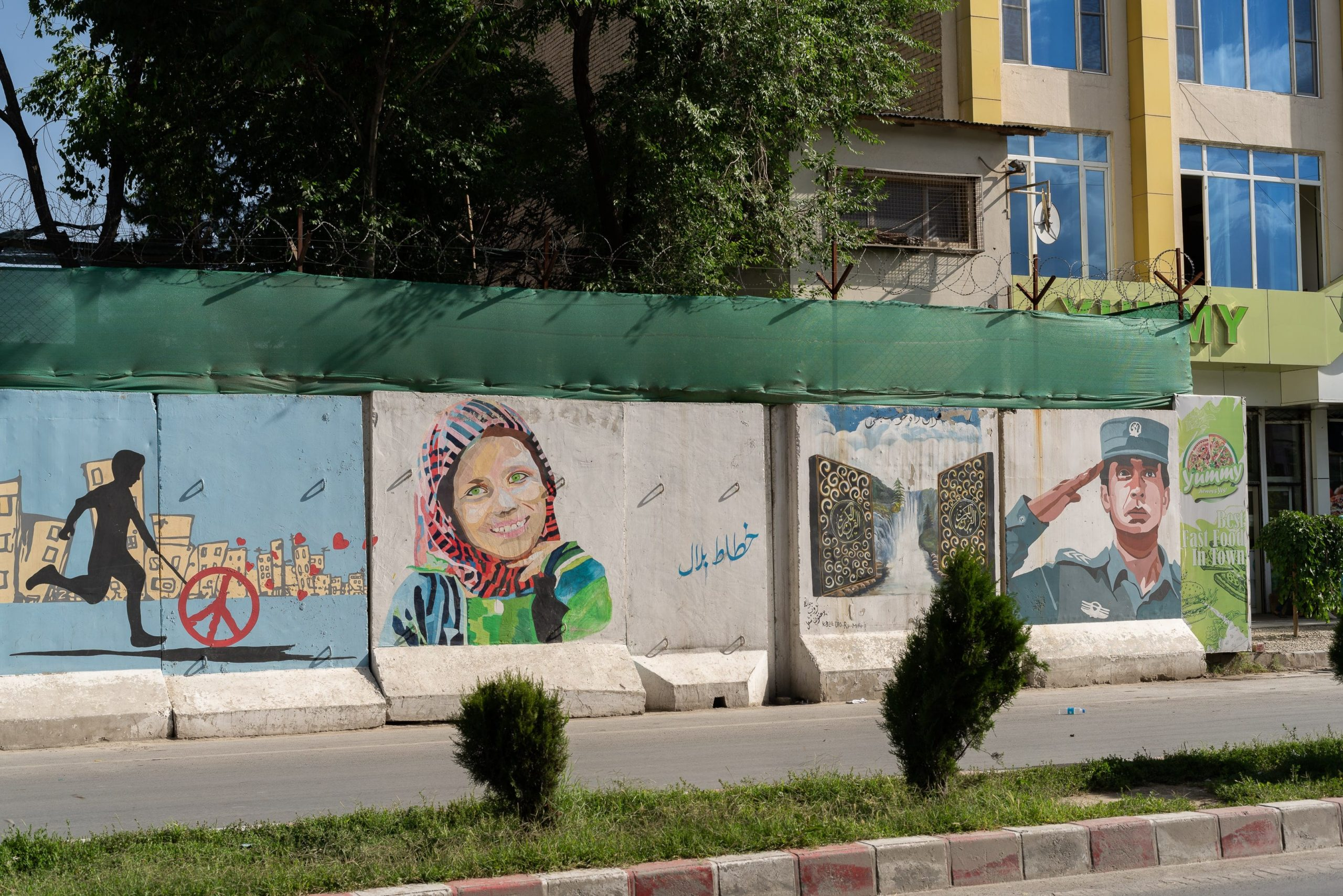 A blast wall in Kabul that has been painted with graffiti promoting peace.