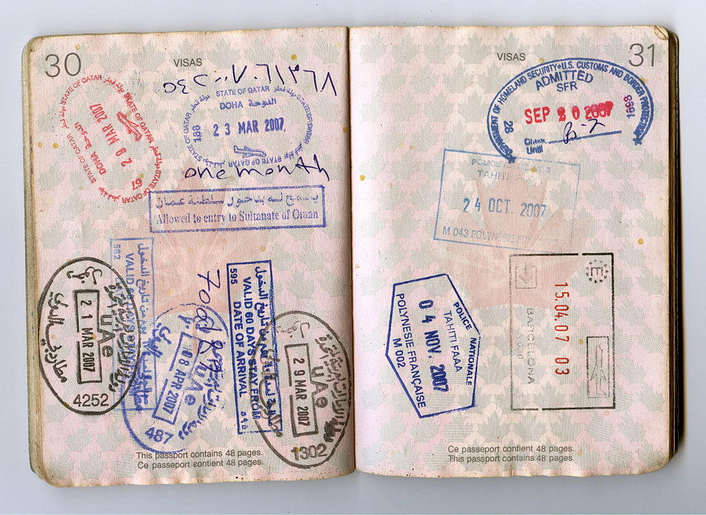 A photograph of a passport showing enterance stamps.