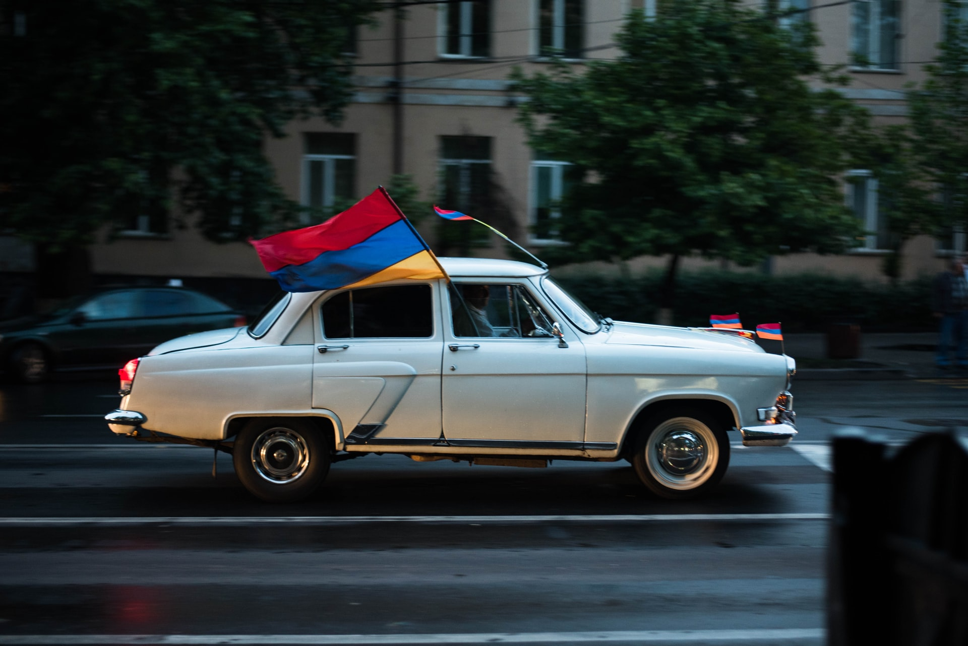 old car with armenian flags