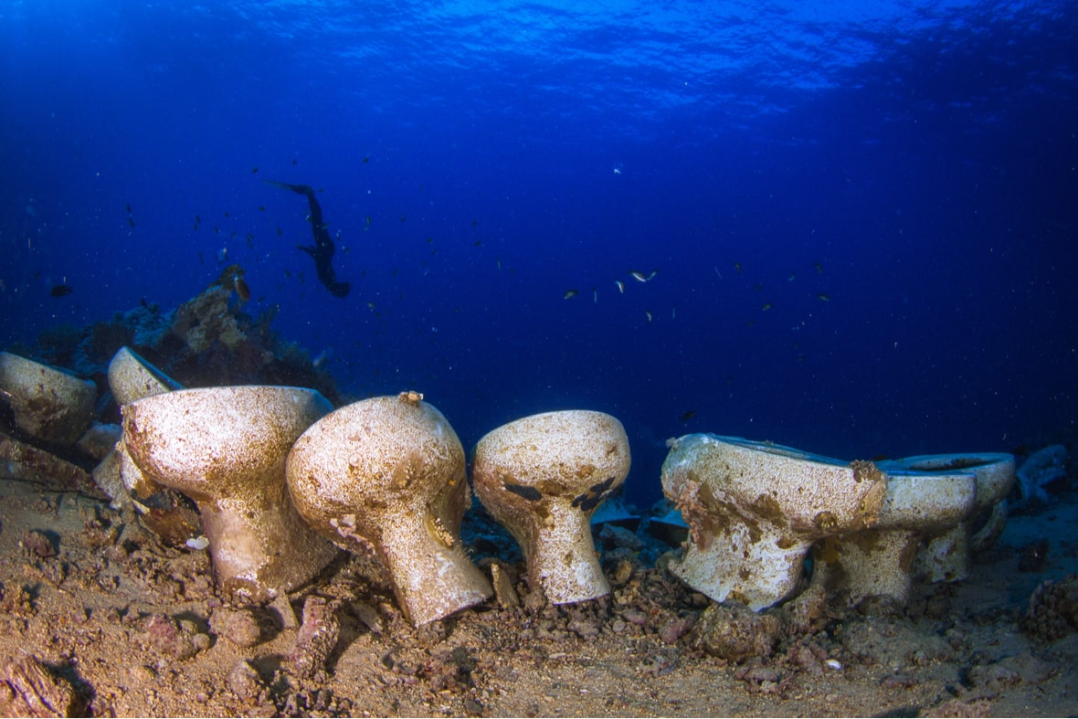 Four underwater toilets looking gross as a reminder to sailors that how you poop on a boat is important.