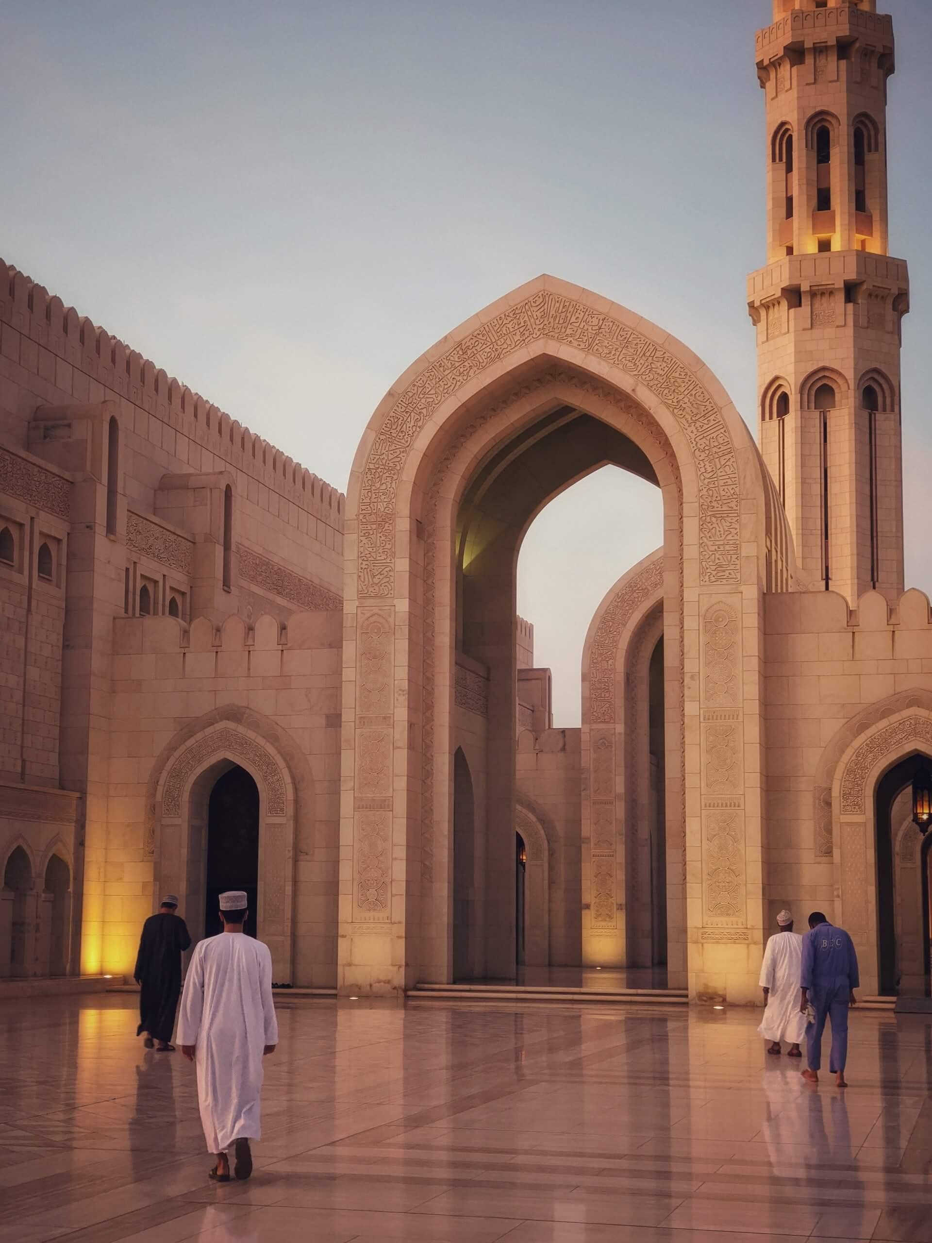 Several Omani men attending prayer at the Sultan Qaboos Mosque