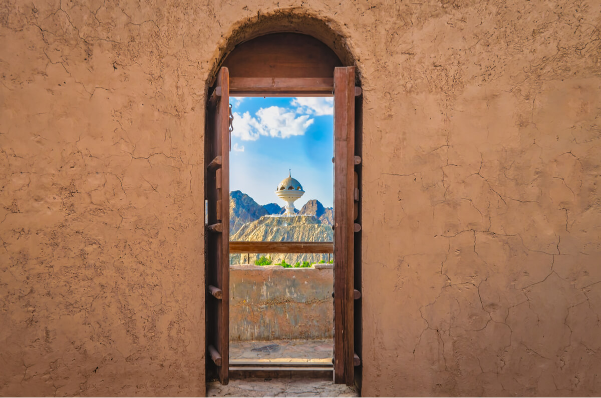 A window looking out at a famous tourist attraction in Oman