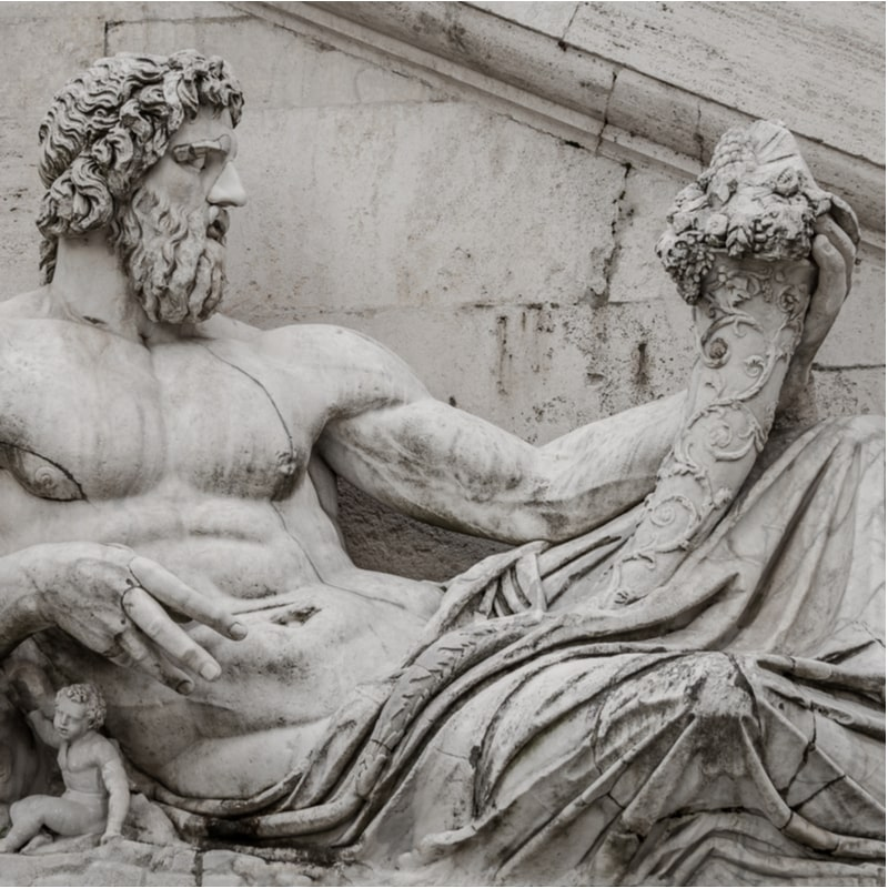 A sculpture of King Neptune with very defined abs