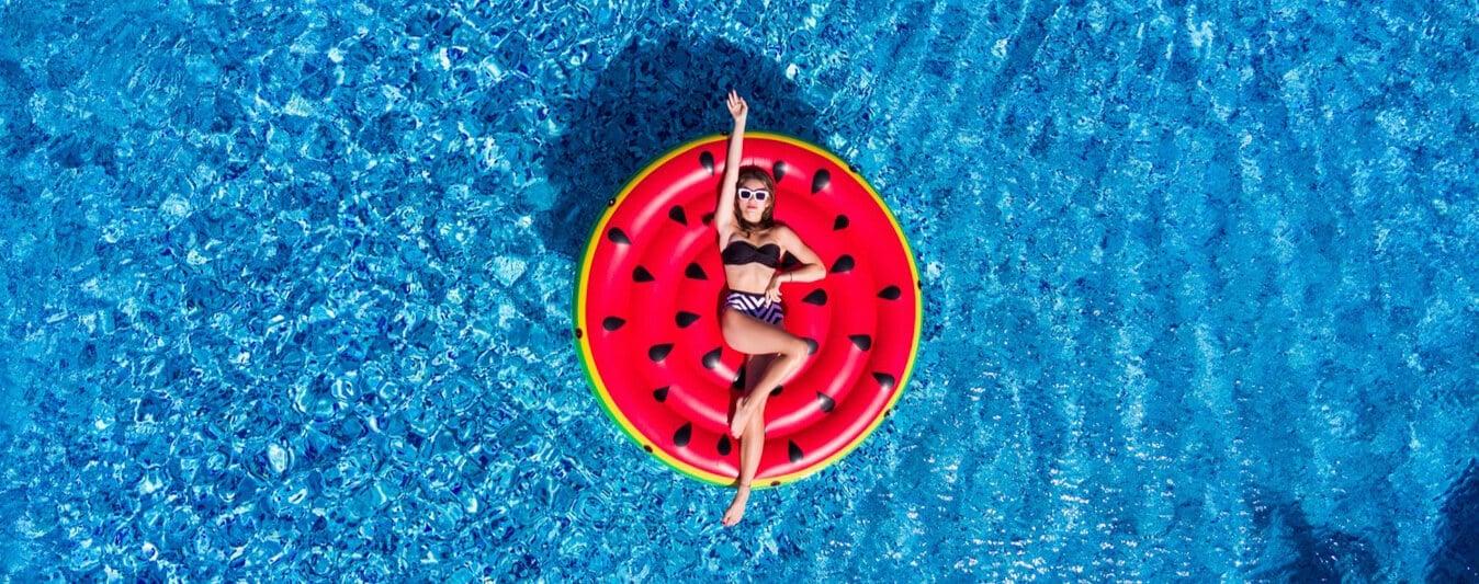 An influncer posing in a pool floatie