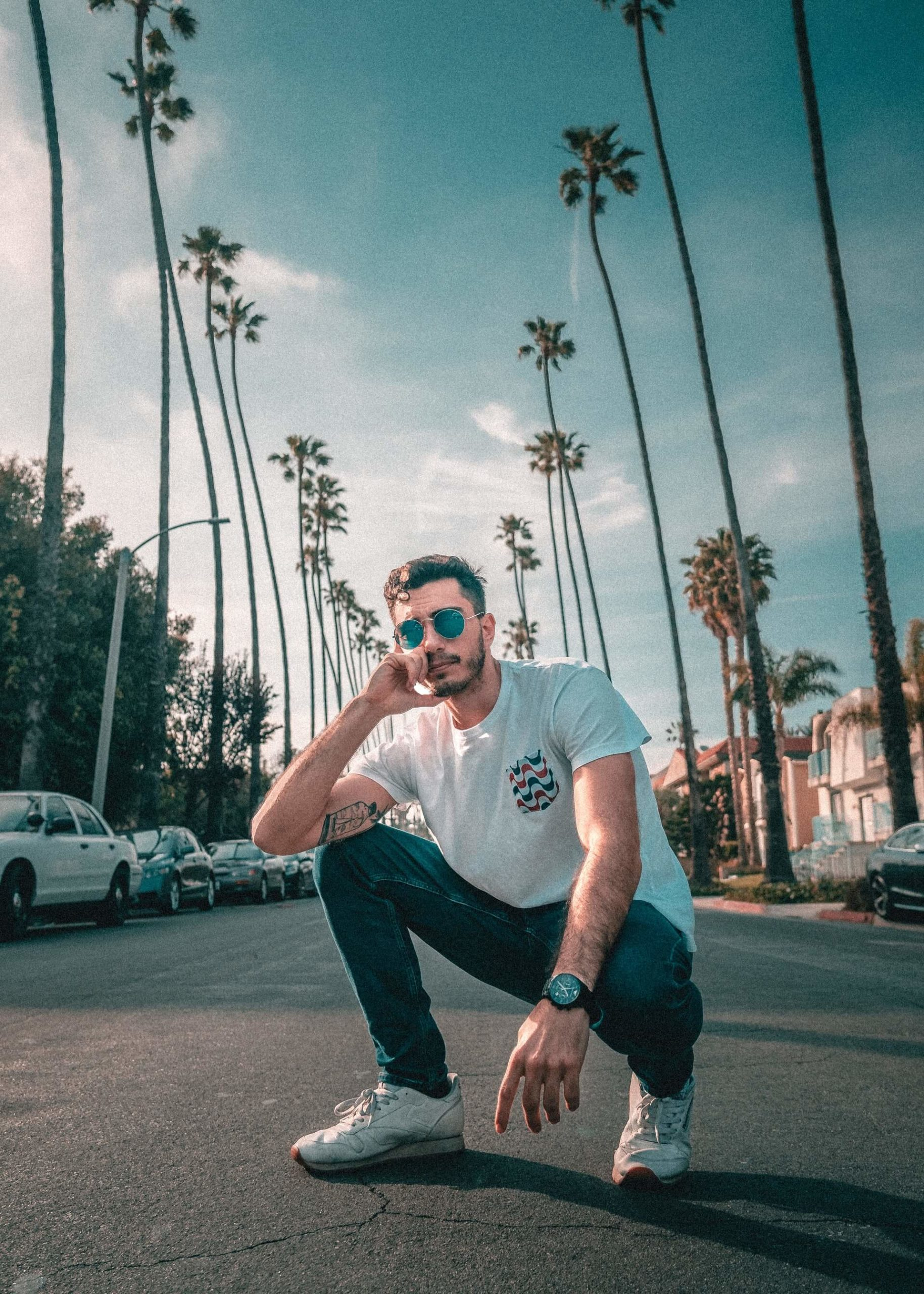 An influencer posing in the street trying hard not to look like a tool and failing