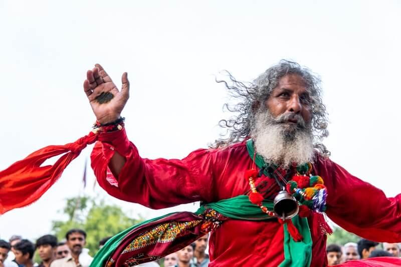 man dancing at sufi festival in pakistan
