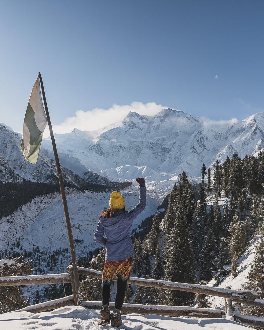 Marsha Jean at a lookout in Pakistan cheering at the view of Nanga Prabat.