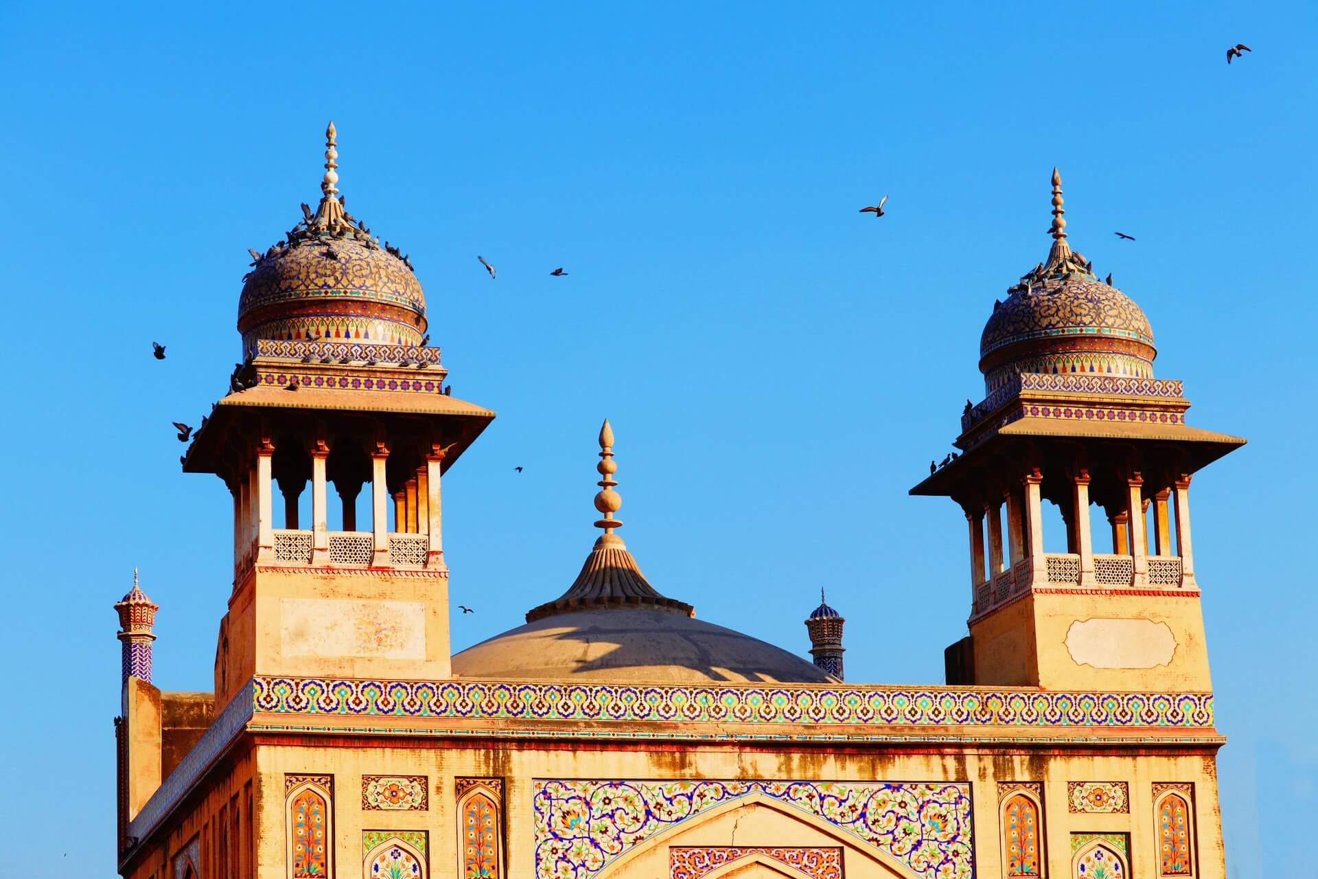 shot of the colorful details of the wazir khan masjid in lahore reasons to travel to pakistan